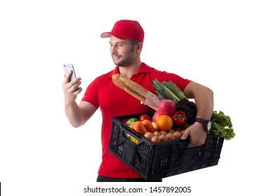 Delivery boy holding smartphone for check information with white background.