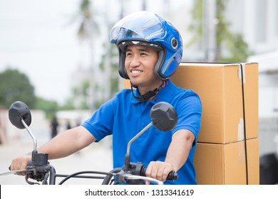 Delivery boy on motorcycle with trunk parcel box driving to fast in rush. Courier delivering order online. Express delivery within specified time by scooter concept