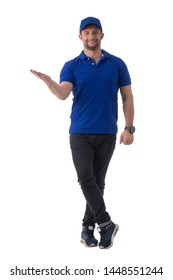 Delivery boy posting with uniform in studio.
