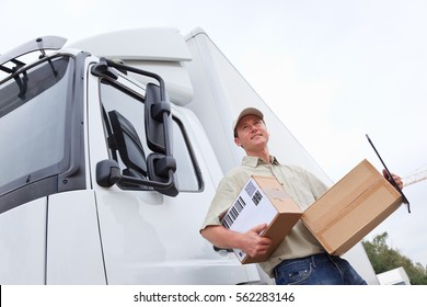 Delivery Boy Standing Next To A Truck