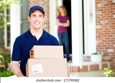 Delivery: Cheerful Delivery Man With Homeowner in Doorway