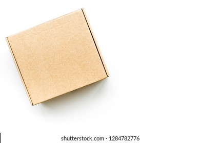 Delivery concept. Cardboard box on white background top view mockup
