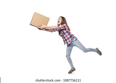 Delivery concept. Full length excited woman running hurrying carrying cardboard box, isolated on white background