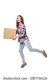 Delivery concept. Full length woman running hurrying carrying cardboard box, isolated on white background