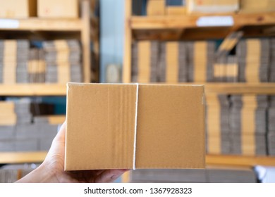 Delivery concept. Group of parcels with clipboard, close up