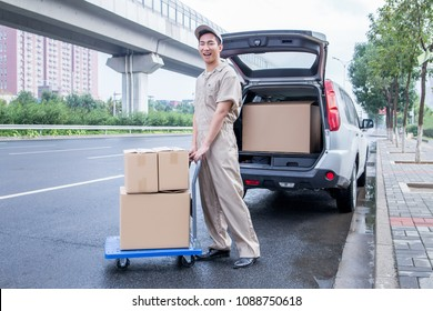 Delivery driver driving van with parcels