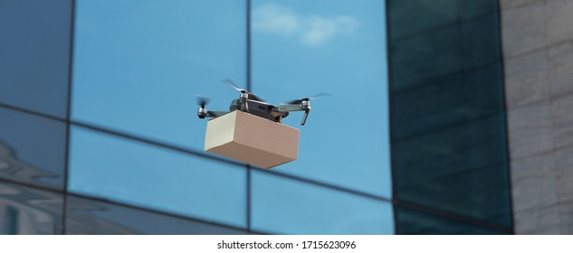 Delivery drone with parcel box flying in city. Quadcopter delivery service, modern cargo drone