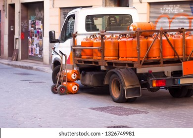 Delivery of gas cylinders.  Truck delivered propane cylinders. Many gas tanks