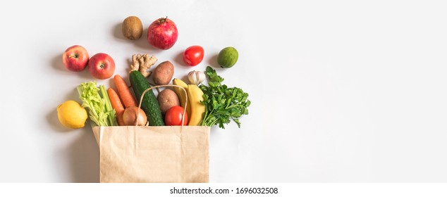 Delivery healthy food background. Vegan vegetarian food in paper bag vegetables and fruits on white, copy space, banner.Grocery shopping food supermarket and clean vegan eating concept. - Shutterstock ID 1696032508