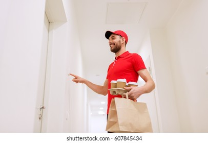 delivery, mail and people concept - happy man delivering coffee and food in disposable paper bag to customer home and ringing doorbell