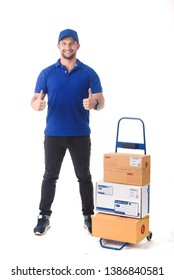 Delivery man in blue uniform of delivery service with trolley, online shopping delivery concept