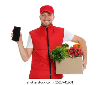 Delivery man with box of fresh vegetables and smartphone on white background, mockup for design