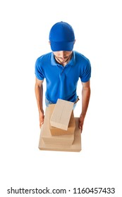 Delivery man with boxes in blue uniform isolated on white background, top view, fish eye lens shot