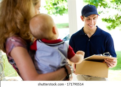 Delivery: Man Checking Clipboard For Address Confirmation