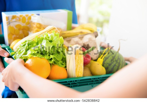 Delivery man delivering food to customer - online grocery shopping service concept