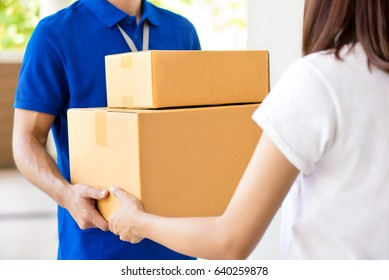 Delivery man delivering parcel boxes to a woman