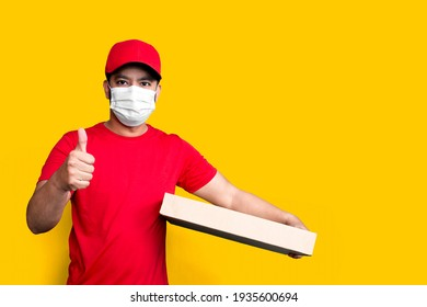 Delivery man employee in red cap blank t-shirt uniform face mask