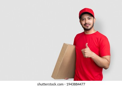 Delivery man employee in red cap blank t-shirt finger uniform ho