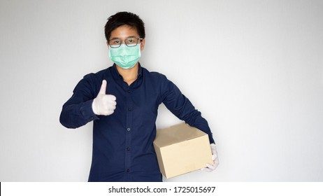 Delivery man employee wearing face mask gloves hold empty cardboard box isolated on white background studio Service quarantine pandemic coronavirus virus 2019-ncov concept