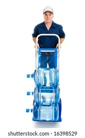Delivery man with fifteen gallons of drinking water on a hand truck.  Full body isolated on white.