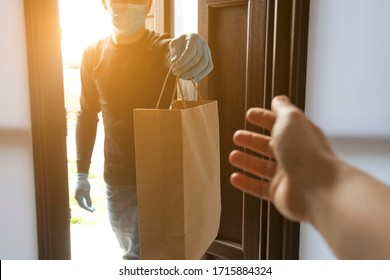 The delivery man gives the bag to the woman at her home