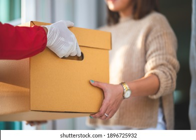 delivery man Giving Boxes To Young women At Home,courier service concept