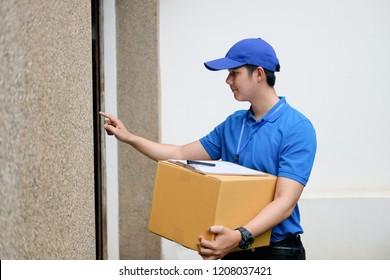 Delivery man hand ringing doorbell.