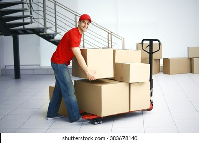 Delivery man with hand truck, close up