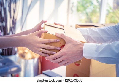 Delivery man is handing packages to a woman