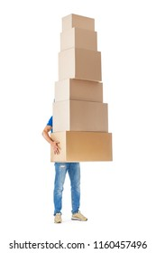 Delivery man hiding behind large stack of cardboard boxes isolated on white background