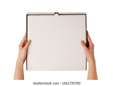 Delivery man holding blank pizza box mockup in hand isolated on white, top view. Deliver guy holds meal box mock up. Fast food packaging template. Pizzeria company identity branding.