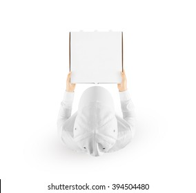 Delivery man holding blank pizza box mockup in hand isolated on white, top view. Deliver guy in clear uniform hold meal box mock up. Fast food packaging template. Pizzeria company identity branding.