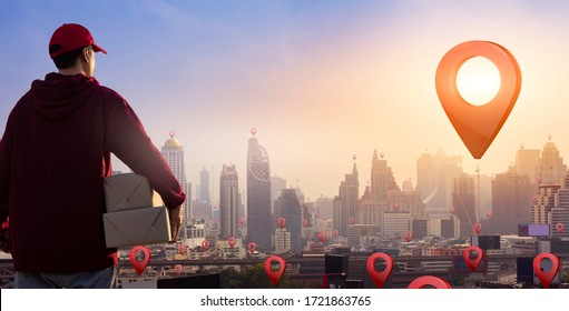Delivery man holding parcel boxes on map pin location. Fast and free delivery transport. Online Shopping and Express delivery Concept. Copy space.