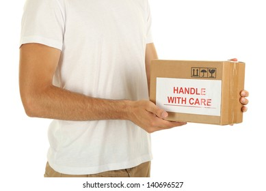 Delivery man holding parcel, isolated on white