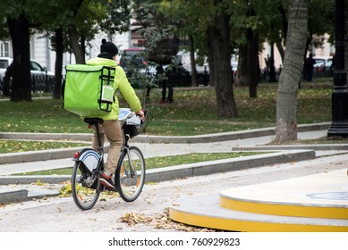 delivery man on the bike in the city roadway