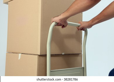 delivery man pushing a trolley with boxes