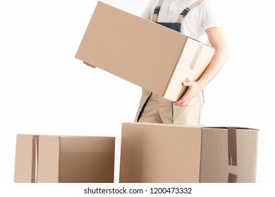 Delivery man puts cardboard box. Relocation service concept. Loader with box. Mover in uniform