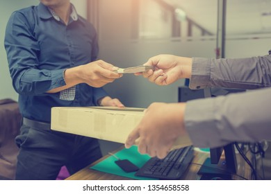 Delivery man receive paying cash payment package courier parcel, people hand giving courier service payment. customer man receiving register package postal box in post office