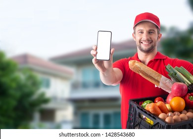 Delivery man show smartphone for prepare to send raw material food to customer