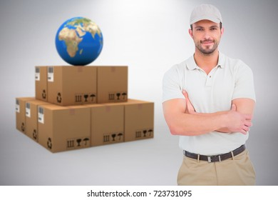 Delivery man standing arms crossed against grey background