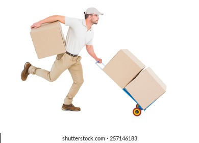 Delivery man with trolley of boxes running on white background