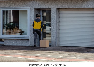 delivery man waiting in front of closed home door rang the bell and watch for customer to open and recieve ordered package box