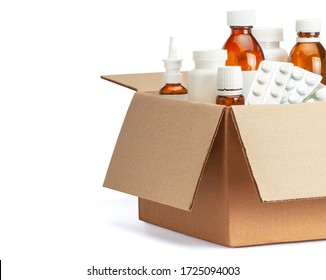 Delivery of medicines home from the pharmacy. Cardboard box with medicines, pills, bottles, sprays. Isolated on a white background.