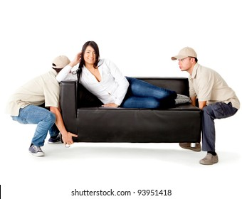 Delivery men carrying a woman lying on the sofa - isolated over a white background