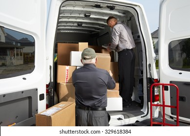 Delivery men with parcels near cargo truck. Post service.