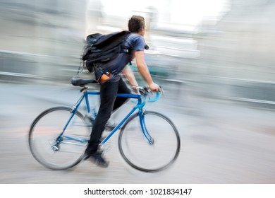 delivery on the bike in traffic on the city roadway  motion blur