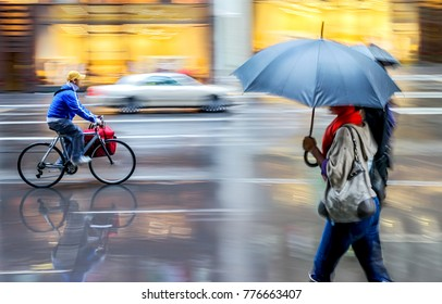 delivery on the bike in traffic on the city roadway  in rain