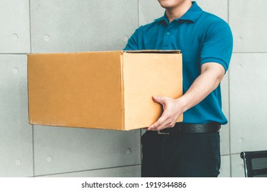 Delivery person carrying parcel box to send to customer . Delivery business concept .