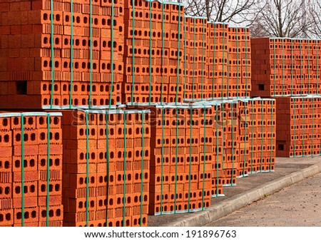 Delivery of red bricks for the construction of a new home by Builders.
