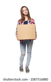 Delivery, relocation and unpacking. Smiling young female holding cardboard box standing in full length, isolated on white background